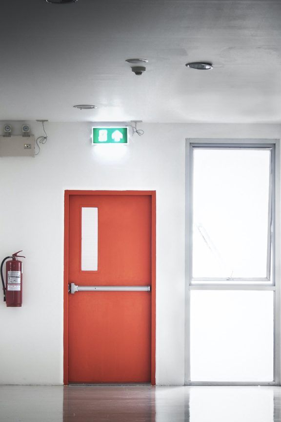 Corridor with fire exit door at the end